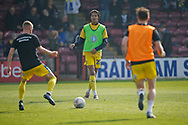 Wimbledon defender Toby Sibbick (20) warming up during the EFL Sky Bet League 1 match between Scunthorpe United and AFC Wimbledon at Glanford Park, Scunthorpe, England on 30 March 2019.
