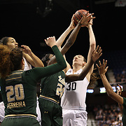 Breanna Stewart, UConn, rebounds over Alisia Jenkins, USF, during the UConn Huskies Vs USF Bulls Basketball Final game at the American Athletic Conference Women's College Basketball Championships 2015 at Mohegan Sun Arena, Uncasville, Connecticut, USA. 9th March 2015. Photo Tim Clayton