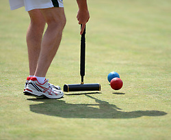 © Licensed to London News Pictures. 14/08/2013. Surbiton, UK Ed Cunningham, Ireland in action. People participate in the14th World Association Croquet Championship at the Surbiton Croquet Club, Kingston upon Thames on the 14th August 2013. The Final will be played on Sunday 18th August. 80 competitors from 20 countries are taking part. Photo credit : Mike King/LNP