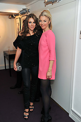 Left to right, ELIZABETH HURLEY and TAMARA BECKWITH at a private view of photographs by Anthony Souza held at The Little Black Gallery, 13A Park Walk, London SW10 on 13th December 2011.