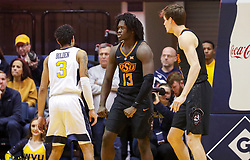 Jan 12, 2019; Morgantown, WV, USA; Oklahoma State Cowboys guard Isaac Likekele (13) reacts after a play during the second half against the West Virginia Mountaineers at WVU Coliseum. Mandatory Credit: Ben Queen-USA TODAY Sports
