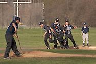 oshen, New York - John S. Burke Catholic players run the bases after a varsity baseball game on April 21, 2014.