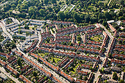 Nederland, Amsterdam, Amsterdam-Oost, 17-06-2008; Watergraafsmeer: Betondorp, met de Veeteeltstraat naar de Brink (diagonaal van midden onder naar links midden links); boven in beeld de Oosterbegraafplaats (Nieuwe Ooster); pannen, daken, pannendak; Reve, de Avonden cementwijk, stadsgroen, arbeiderwijk..luchtfoto (toeslag); aerial photo (additional fee required); .foto Siebe Swart / photo Siebe Swart