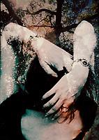 Woman entering dark forest.
