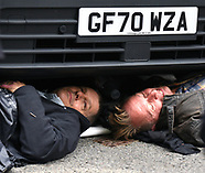 Extinction Rebellion protestors  chained  under a van