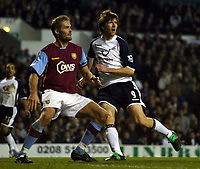 Photo: Chris Ratcliffe.<br />Tottenham Hotspur v Aston Villa. The Barclays Premiership. 21/01/2006.<br />Grzegorz Rasiak (R) of Spurs tussles with Olof Melberg of Villa.