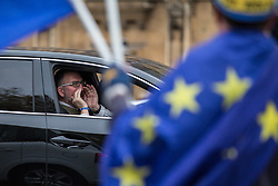 © Licensed to London News Pictures. 14/11/2017. London, UK. A Brexit supporter in a car shouts at anti-Brexit protesters demonstrating outside Parliament as MPs debate the European Union (Withdrawal) Bill. Photo credit: Rob Pinney/LNP