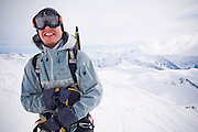 Backcountry skier Nathan Kurz smiles with excitement on the summit of Little Diamond Head, Garibaldi Provincial Park, British Columbia, Canada.
