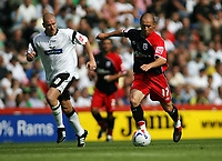 Photo: Rich Eaton.<br /> <br /> Derby County v Southampton. Coca Cola Championship.<br /> <br /> 06/08/2006. Southamptons Djamel Belmadi #17 takes on Derbys Seth Johnson #18