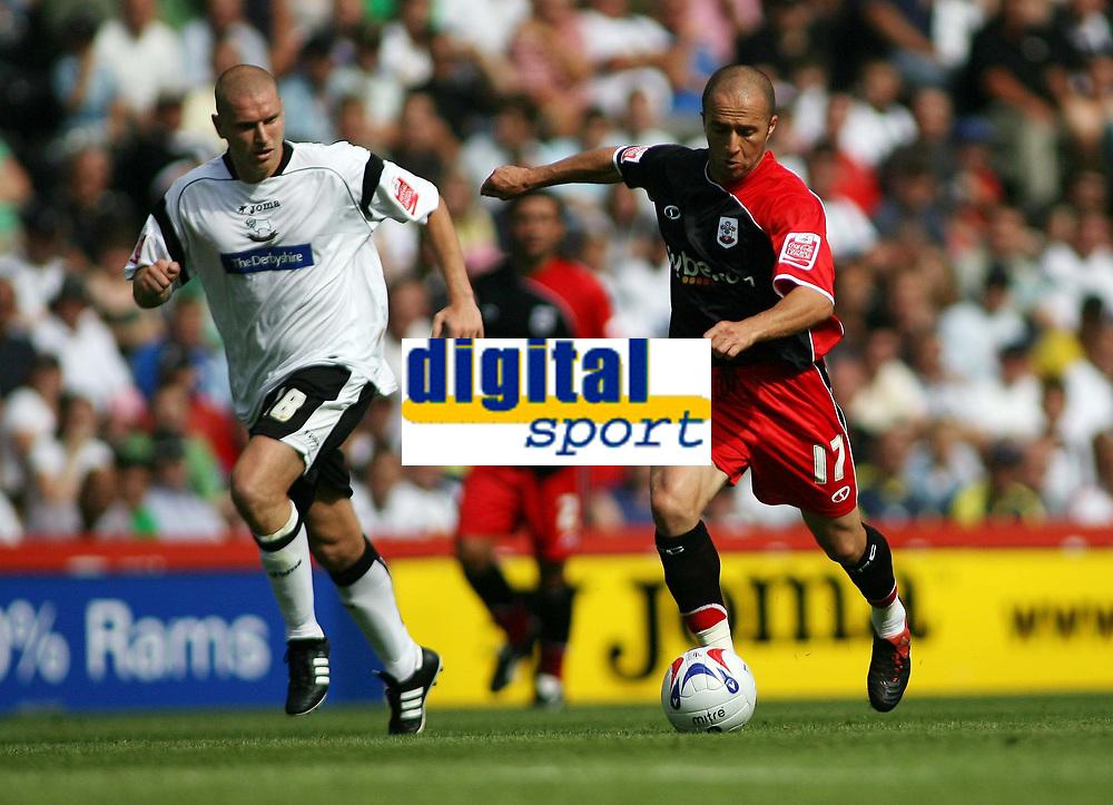 Photo: Rich Eaton.<br /> <br /> Derby County v Southampton. Coca Cola Championship.<br /> <br /> 06/08/2006. Southamptons Djamel Belmadi #17 takes on Derbys Seth Johnson #18