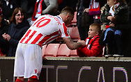 Marko Arnautovic of Stoke city gives his boots to a young fan.  Premier league match, Stoke City v West Ham Utd at the Bet365 Stadium in Stoke on Trent, Staffs on Saturday 29th April 2017.<br /> pic by Bradley Collyer, Andrew Orchard sports photography.