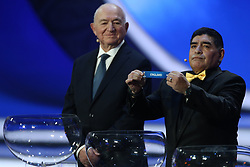 December 1, 2017 - Moscow, Russia - Draw assistant, Diego Maradona (R) draws England during the Final Draw for the 2018 FIFA World Cup Russia at the State Kremlin Palace on December 1, 2017 in Moscow, Russia. (Credit Image: © Igor Russak/NurPhoto via ZUMA Press)