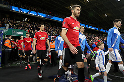 Manchester United's Michael Carrick leads out his team before the Emirates FA Cup, Fifth Round match at The John Smith's Stadium, Huddersfield