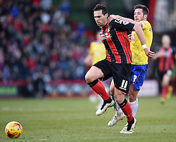 Bournemouth's Charlie Daniels charges past Huddersfield Town's Jacob Butterfield - Photo mandatory by-line: Paul Knight/JMP - Mobile: 07966 386802 - 14/02/2015 - SPORT - Football - Bournemouth - Goldsands Stadium - AFC Bournemouth v Huddersfield Town - Sky Bet Championship