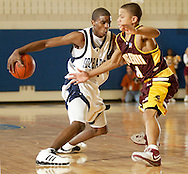 Newburgh Free Academy's Quillar Marion, left, starts to dribble the ball behind his back as  Mount Vernon's Ketema Brooks defends during a Class AA state tournament game at SUNY New Paltz on on March 9, 2007.