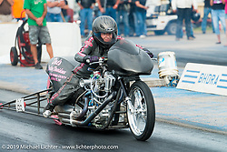 "Kersten Heling, daughter of Steve ""Doc"" Hopkins off the line at the Sturgis Drag Race Finals on Wednesday. Kersten was the youngest licensed nitro Harley-Davidson dragracer in history at the age of 16 in 1995 and is sponsored by Doc's Harley-Davidson. Annual Sturgis Black Hills Motorcycle Rally. SD, USA. August 6, 2014.  Photography ©2014 Michael Lichter."