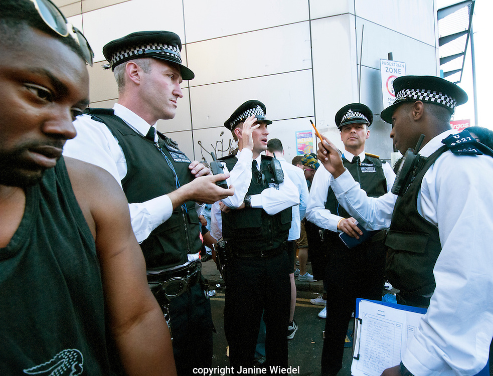 Policeman instructing group of police officers at Brixton Splash festival