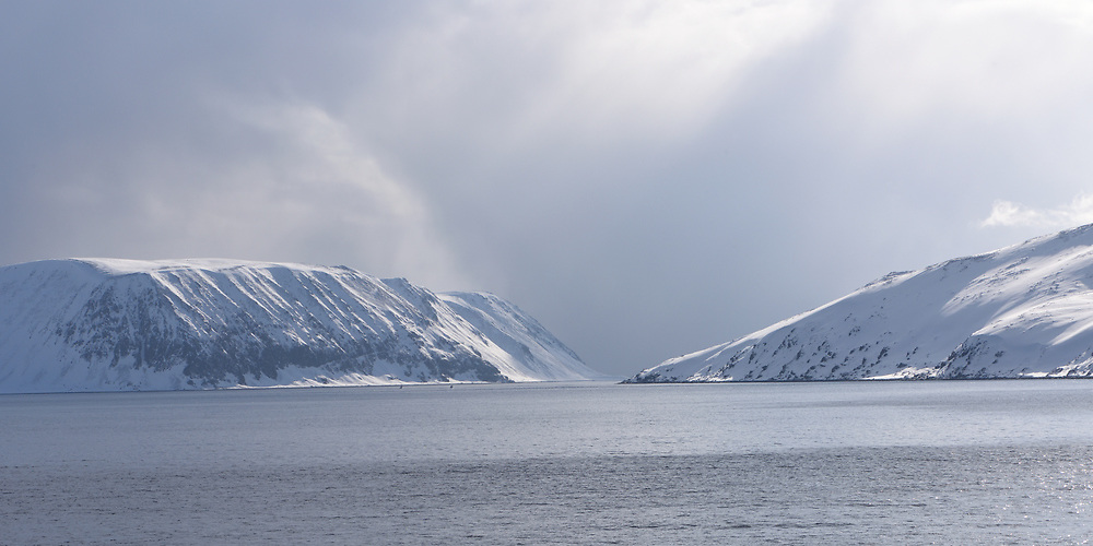 A snowy, winter landscape seen from the Hurtigruten route from Havøysund to Honningsvåg. Finnmark,  Norway