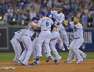 Sep 30, 2014; Kansas City, MO, USA; The Kansas City Royals celebrate after catcher Salvador Perez hits a walk off single to beat the Oakland Athletics in extra innings during the 2014 American League Wild Card playoff baseball game at Kauffman Stadium.