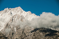 Early morning clouds move across the face of Mount Whitney, Eastern Sierras, California.