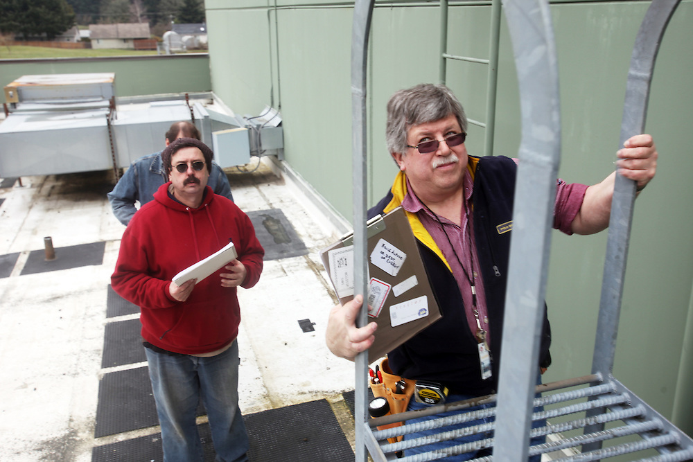 Lane Community College energy management instructor Bruce Alford and his students inspect boilers, lighting and air condiiton units to build an energy audit of Judson Middle School in Salem on Friday, March 4, 2011.
