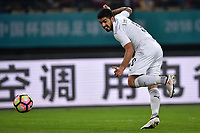 """Luis Suarez of Uruguay national football team kicks the ball to make a pass against Wales national football team in their final match during the 2018 Gree China Cup International Football Championship in Nanning city, south China's Guangxi Zhuang Autonomous Region, 26 March 2018.<br /> <br /> Edinson Cavani's goal in the second half helped Uruguay beat Wales to claim the title of the second edition of China Cup International Football Championship here on Monday (26 March 2018). """"It was a tough match. I'm very satisfied with the result and I think that we can even get better if we didn't suffer from jet lag or injuries. I think the result was very satisfactory,"""" said Uruguay coach Oscar Tabarez. Wales were buoyed by a 6-0 victory over China while Uruguay were fresh from a 2-0 win over the Czech Republic. Uruguay almost took a dream start just 3 minutes into the game as Luis Suarez's shot on Nahitan Nandez cross smacked the upright. Uruguay were dealt a blow on 8 minutes when Jose Gimenez was injured in a challenge and was replaced by Sebastian Coates. Inter Milan's midfielder Matias Vecino of Uruguay also fired at the edge of box from a looped pass but only saw his attempt whistle past the post. Suarez squandered a golden opportunity on 32 minutes when Ashley Williams's wayward backpass sent him clear, but the Barca hitman rattled the woodwork again with goalkeeper Wayne Hennessey well beaten."""