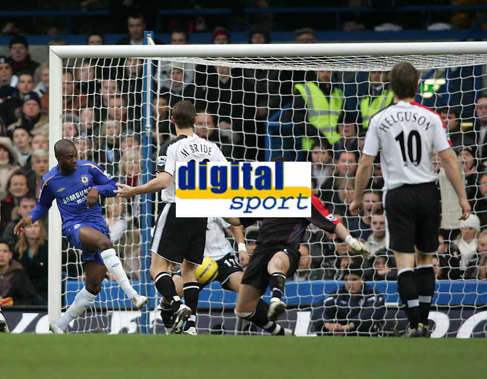 Photo: Lee Earle.<br /> Chelsea v Fulham. The Barclays Premiership. 26/12/2005. Chelsea's William Gallas (L) beats Fulham keepers Mark crossley to open the scoring.