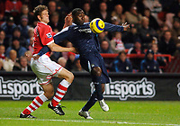 Photo: Daniel Hambury.<br />Charlton Athletic v Manchester City. Barclays Premiership.<br />04/12/2005.<br />Charlton's Hermann Hreidarsson gets to grips with City's Andrew Cole.