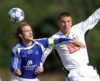 Fotball 2. divisjon 27.08.05 - Ranheim - Mo 4-2<br /> Kristian Juberg, Ranheim, Torstein Vassdal, Mo<br /> Foto: Carl-Erik Eriksson, Digitalsport