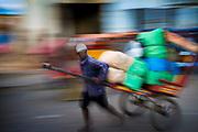 Antsirabe, Madagascar. Rickshaw cargo man. Central Highlands.