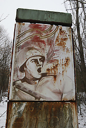 December 22, 2016 - Kiev, Ukraine - A Soviet baner is seen in the deserted town of Pripyat,two kilometers from the Chernobyl nuclear power plant, Ukraine, on 22 December,2016. The explosion of Unit four of the Chernobyl nuclear power plant on 26 April 1986 is still regarded the biggest accident of nuclear power generation  in the history. (Credit Image: © Serg Glovny via ZUMA Wire)