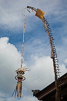 A Balinese Penjor is a construction made of bamboo and wicker that is put up along the streets in Bali for the Galungan Ceremony, held every six months on the Balinese calendar.