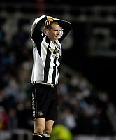 Photo: Jed Wee.<br /> Newcastle United v Chelsea. Carling Cup. 20/12/2006.<br /> <br /> Newcastle's Peter Ramage feels the pain of defeat.