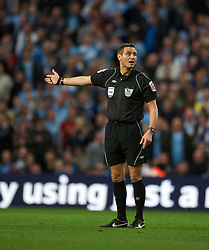 MANCHESTER, ENGLAND - Monday, April 30, 2012: Referee Andre Marriner during the Premiership match between Manchester City and Manchester United at the City of Manchester Stadium. (Pic by Chris Brunskill/Propaganda)