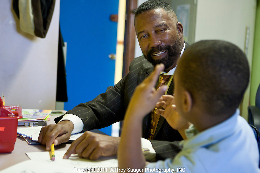 DETROIT, MI - NOVEMBER, 16: Robert C. Bobb, Emergency Financial Manager of Detroit Public Schools, left, tutors Darrius Evans, right, at Thirkell Elementary School, in Detroit, MI, Tuesday, November 16, 2010. Bobb tutors two kindergarteners every week as a volunteer in the DPS Reading Corps. (Photo by Jeffrey Sauger)