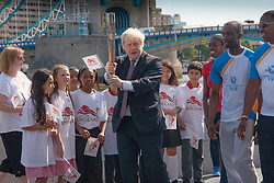 London, June 6th 2014. Mayor of London Boris Johnson and children from Alfred Salter Primary School join Olympic and Commonwealth champion Christine Ohuruogu MBE to welcome the Commonwealth GamesQueen's Baton Relay to the Capital.