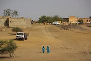 Two men dressing Tuareg clothing walking in Timkuktu, in Mali.