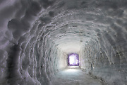 "Iceland Opens Man-Made Ice Tunnel in Langjokull Glacier<br /> <br /> The world's largest man-made ice tunnel was recently dug out on the western slopes of one of the biggest glaciers in Iceland - Langjokull. The tunnel and cave system stretches for 550 meters into solid glacier ice at about 30 meters below the surface making it the largest man made ice structure in the world. This unique project, backed by the Icelandair Group and leading pension funds, will enable visitors to have a rare opportunity to see how snow is gradually compressed to become glacier ice.<br /> <br /> Aptly named ""Into the Glacier"", the experience is the brainchild of two Icelandic adventure tour operators - Baldvin Einarsson and Hallgrímur Örn Arngrímsson, who wanted to take visitors into the heart of the extraordinary glacier ice cap, to see the magnificent ""blue ice"" which is buried deep beneath the surface.<br /> <br /> Work on the cave began in 2010, and completed early this year. It was official opened for visitors on 1st June 2015. Although its meant primarily to be a tourist attraction, the tunnel will also be used by researchers and students at the University of Iceland to measure ice movements over time.<br /> <br /> The journey to the ice tunnel starts off with an epic trip in 8-wheel monster trucks to the entrance of the cave, which is located 1,200 meters above sea level. From there visitors are taken on foot on an hour-long tour exploring the tunnel where they will see crevasses, moulins, running water, ice layers and space between them, different types of snow and ice, and how the glacier evolves. The led lighted walls inside the tunnels are sheer-carved and hollowed out at various intervals along the tunnel to house educational exhibitions and provide information on the science of glaciers and the effects of global warming. There is even a small chapel where couples can get married.<br /> <br /> The attraction is expected to stay open all throughout the year.<br /> ©Roman Gerasymenko/Exclusivepix Media"