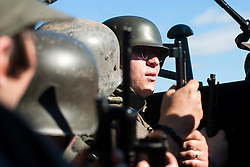 Re-enactors portraing German Panzer Grenadiers prepare for a Battle reenactment on Day one at the Showground Pickering<br /> 13 October 2012<br /> Image © Paul David Drabble