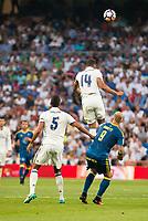 Real Madrid's player Raphael Varane and Carlos Henrique Casemiro and Celta de Vigo's player John Guidetti during a match of La Liga Santander at Santiago Bernabeu Stadium in Madrid. August 27, Spain. 2016. (ALTERPHOTOS/BorjaB.Hojas)
