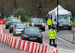 © Licensed to London News Pictures. 05/01/2021. London, UK. Members of the public queue up in their cars at a Covid-19 testing centre in Hyde Park, London as cases continue to rise dramatically throughout the capital with the UK recording a record 58,784 positive tests on Monday. Yesterday, Prime Minister Boris Johnson plunged England into another lockdown as he ordered schools to close and workers to work from home in his address to the nation last night. This week, the first person in the world was vaccinated with the Oxford AstraZeneca Covid-19 vaccine with over 500,000 doses made available for high risk groups as the government race to vaccinate 13 million people in seven weeks. Photo credit: Alex Lentati/LNP