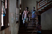 People living in the old hospital of Roça Agostinho Neto are walking down the stairs leading to their rooms, on the island of Sao Tome, Sao Tome and Principe, (STP) a former Portuguese colony in the Gulf of Guinea, West Africa.