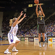 Baylor's Jessica Morrow (R) puts up a three pointer over Kansas State's Claire Coggins (L), during the first half at Bramlage Coliseum in Manhattan, Kansas, February 25, 2006. The 10 ranked Lady Bears defeated K-State 79-70.
