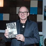 NLD/Amsterdam/20140227 - Boekpresentatie Jeroen van Inkel - Kort Sluiting , Jeroen van Inkel met zijn  boek