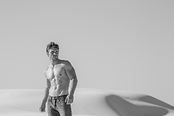 shirtless muscular man in the desert