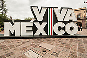 A Viva Mexico sign outside the government palace or Palacio de Gobierno along the Plaza de Armas in the old colonial section of Santiago de Queretaro, Queretaro State, Mexico.