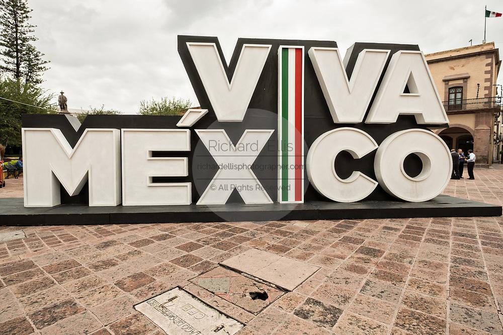 A Viva Mexico sign outside the government palace or Palacio de Gobierno along the Plaza de Armas in the old colonial section of Santiago de Queretaro, Queretaro State, Mexico.
