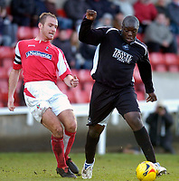 Photo: Alan Crowhurst.<br />Swindon Town v Swansea City. Coca Cola League 1.<br />31/12/2005. <br />Adebayo Akinfenwa (R) charges on for Swansea.