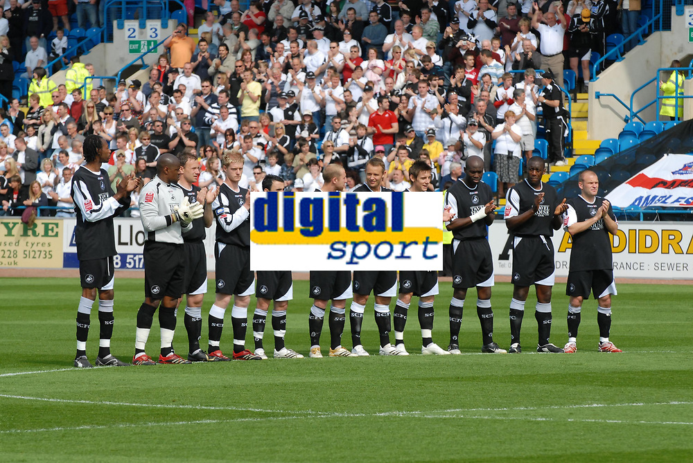 Swansea's players observe a minute's applause in memory of Alan Ball.