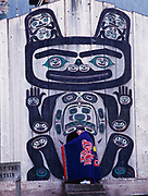 Tlingit elder Marge Byrd of the Kik.setti Clan in entrance to Chief Shakes Tribal House, Shakes Island, Wrangell, Alaska.  Button Blanket depicting Tlingit legend of Raven releasing the sun from a bentwood box.